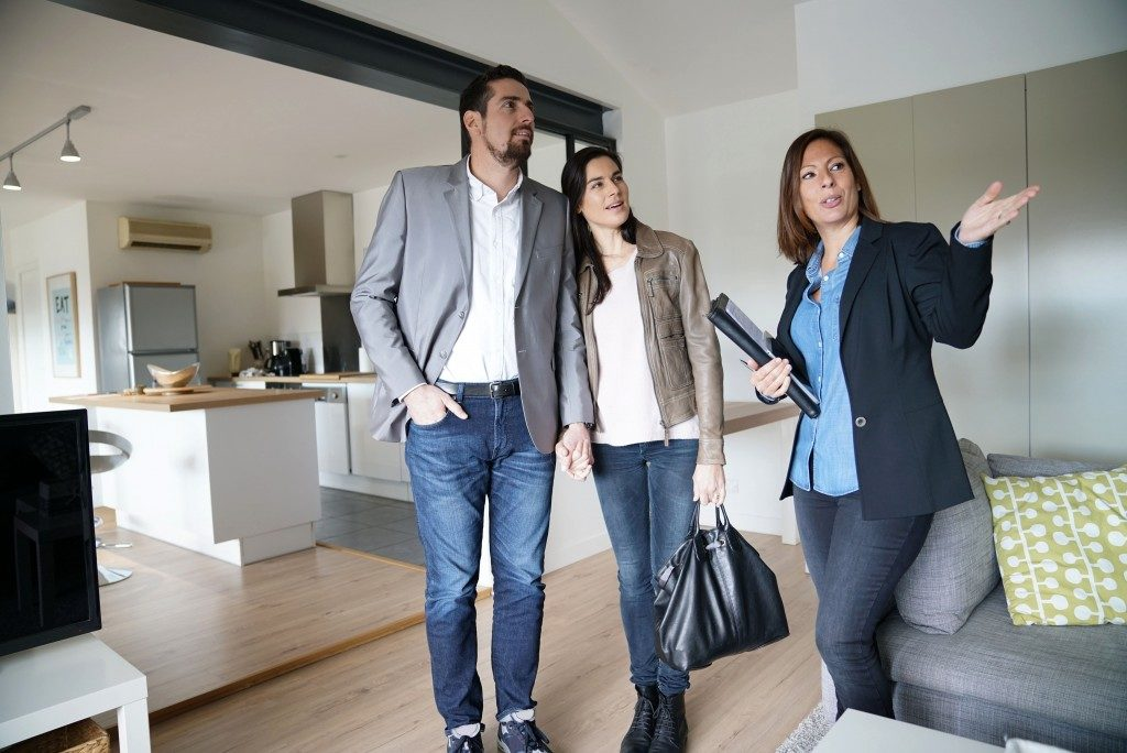 Agent with clients during a house visit