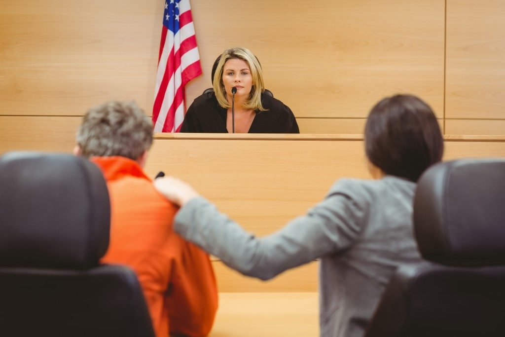Female judge facilitating the trial