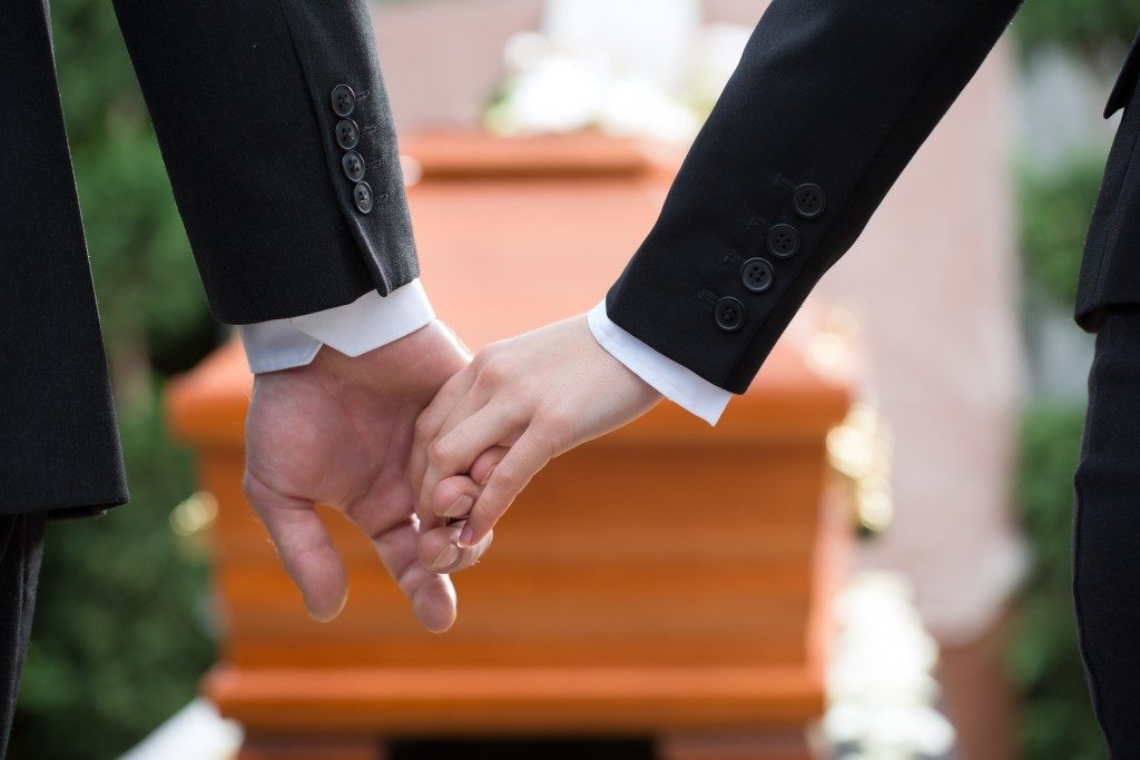 People holding hands because of death of loved one