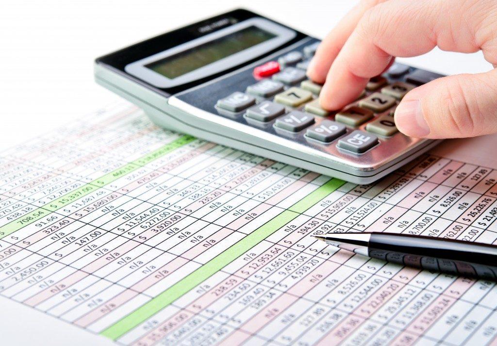 person computing financial statement