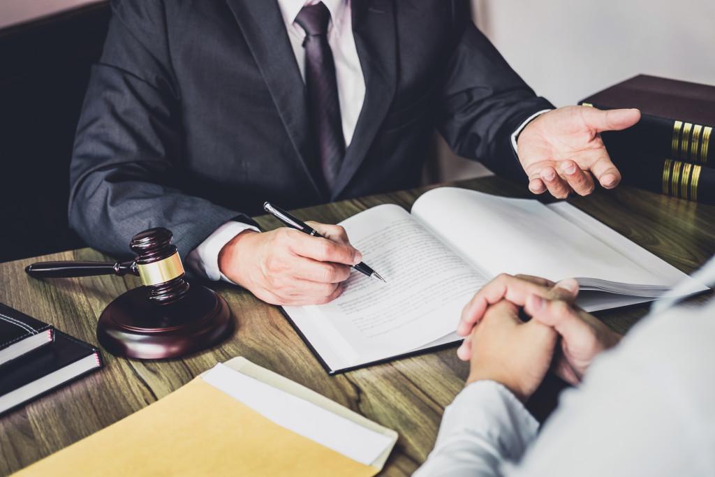 man talking to lawyer